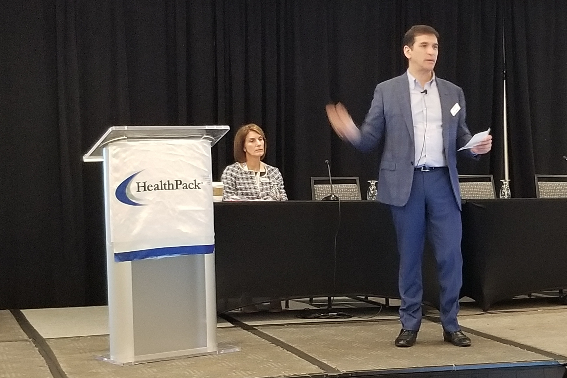 Speaker next to podium at HealthPack 2020