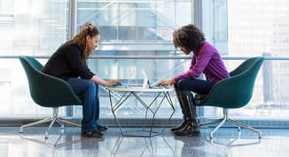 Two women networking