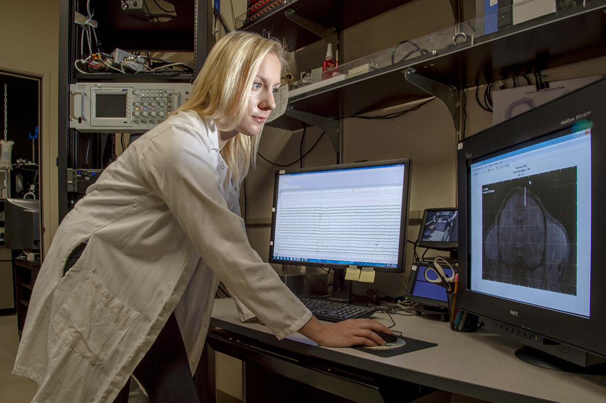 Woman doctoral student in her lab.