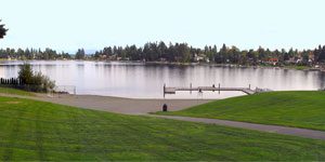Angle Lake with grassy path and dock in foreground.